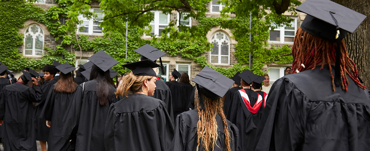 Holyoke graduates walk with other Bard graduates at Commencement.